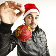 Young guy with christmas ball — Stock Photo