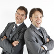 Stock Photo: Two happy smiling businessmen