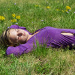Young girl laying on the grass — Stock Photo