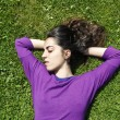 Young girl relaxing on the grass — Stock Photo