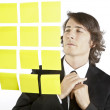 Young businessman looking at postit reminder notes — Stock Photo #13761345