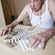 Elder man with pills - Stock Photo