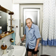 Portrait of elder man in the bathroom — Stock Photo