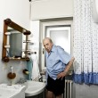 Portrait of elder man in the bathroom — Foto Stock