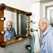 Portrait of elder man in the bathroom — Stock Photo #13763113