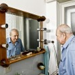 Portrait of elder man in the bathroom — Stock Photo #13763114