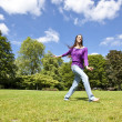 Young girl dancing happy in a park — Stock Photo