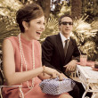 Retro sixties style fashion couple having breakfast outdoor - Stock Photo