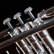 Nice trumpet on black background - Stock Photo