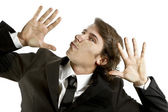 Young businessman crushed on a glass — Stock Photo