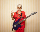 Cool fashion elder lady with electric guitar — Stock Photo