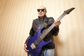 Cool fashion elder man with electric guitar — Stok fotoğraf