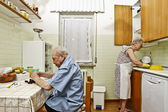 Elderly couple in the kitchen — Stock Photo