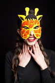Mysterious woman with carnival giraffe mask — Stock Photo