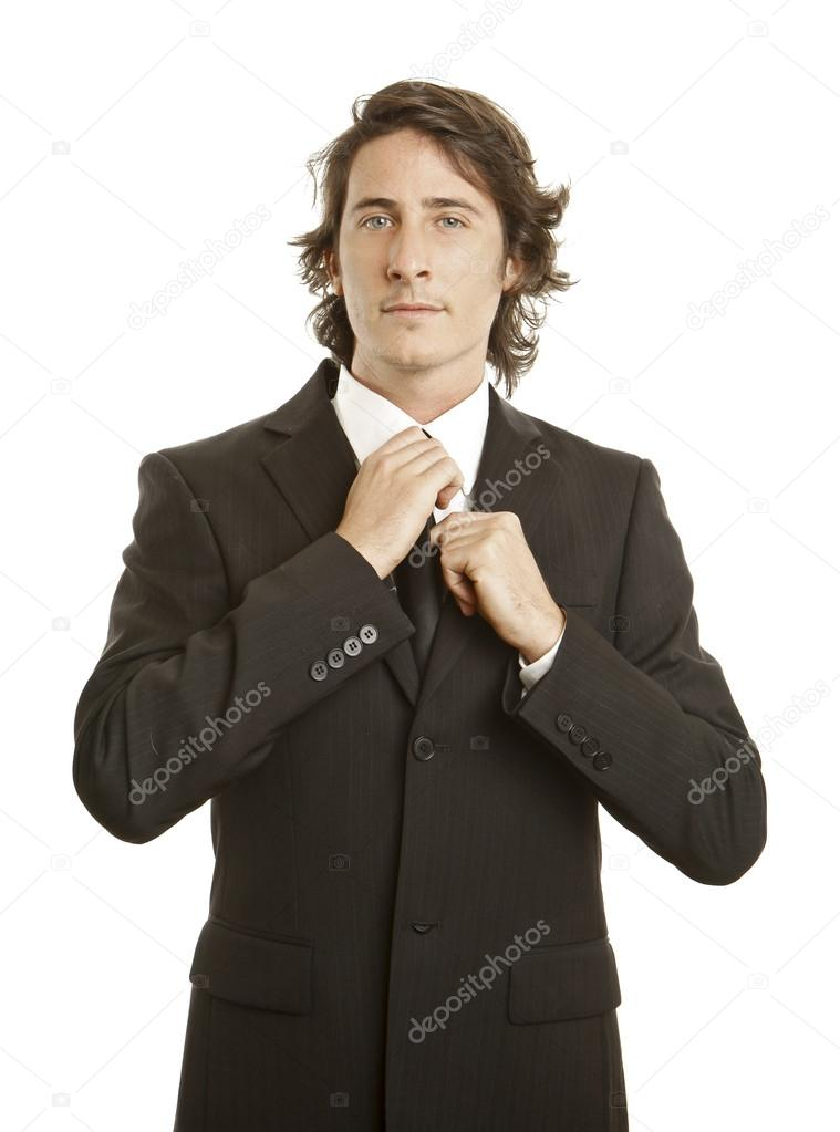 Confident young businessman against white background — Stock Photo #13761407