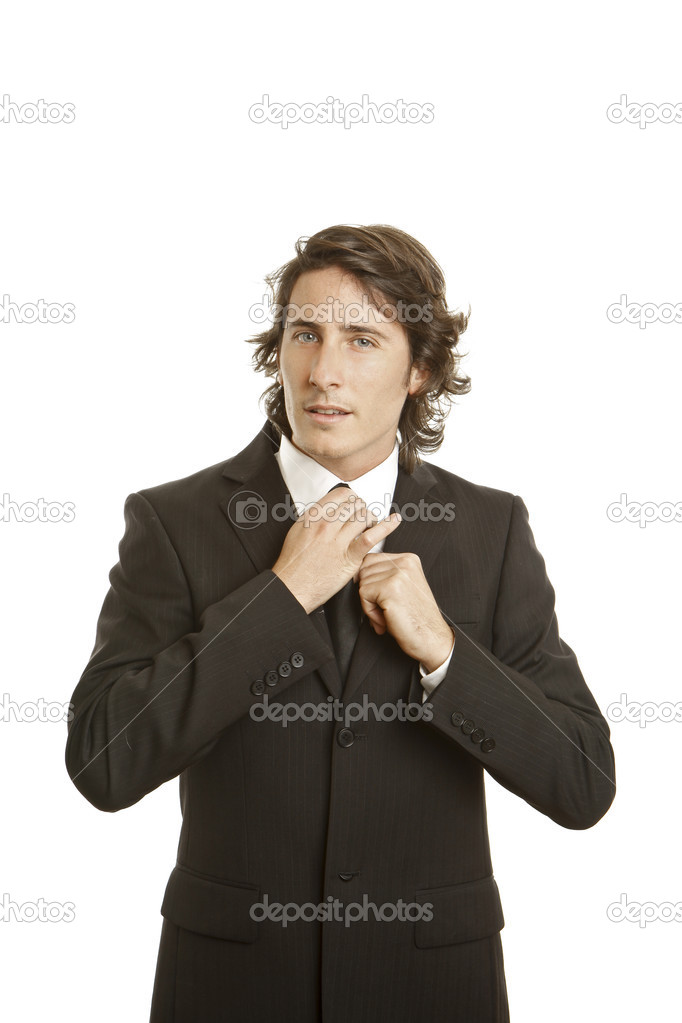 Confident young businessman against white background  Stock Photo #13761408