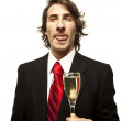 Drunk guy holding champagne galss on a white background — Stock Photo