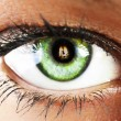 Girl's green eye close up with fire reflected  green eye close u — Stock Photo