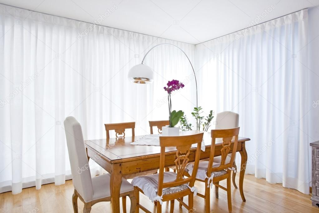 modern dining room with white curtains stock photo