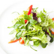Green salad with feta cheese, tomatoes and peppers - Stockfoto