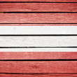 Austrian flag painted on old wood plank background - Stock Photo