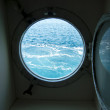 Boat porthole with ocean view — Stock Photo #14521821