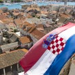 Croatian flag on the city of trogir in dalmatia — Stock Photo #14523531