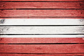 Austrian flag painted on old wood plank background — Stock Photo