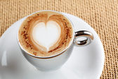 Art latte on a cappuccino coffe cup — Stock Photo