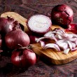 Elegant red onion on a cutting board - Stok fotoğraf