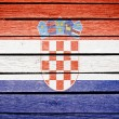 Croatian flag painted on old wood plank background - Stock Photo