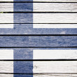 Finland, finnish flag painted on old wood plank background - Stock Photo