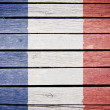 French flag painted on old wood plank background — Stock Photo