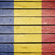 Romania, romanian flag painted on old wood plank background — Stock Photo #14535813