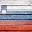 Slovenia, slovenian flag painted on old wood plank background — Stock Photo