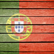 Portuguese, portugal flag painted on old wood plank background - Stock Photo