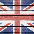 United kingdom flag painted on old wood plank background — Stock Photo