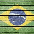 Stock Photo: Brazil, braziliflag painted on old wood plank background