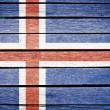 Iceland, icelandic flag painted on old wood plank background — Stock Photo