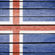 Iceland, icelandic flag painted on old wood plank background — Stock Photo #14536475