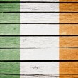 Ireland, irish flag painted on old wood plank background - Stock Photo