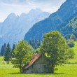 Small wooden house in the mountain — Stock Photo