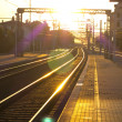 Train station in the sunset - Stock Photo