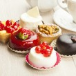 Different sort of beautiful pastry, small colorful sweet cakes — Stok fotoğraf