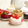 Different sort of beautiful pastry, small colorful sweet cakes - Lizenzfreies Foto