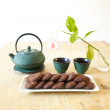 Japanese tea with chocolate biscuits on wooden table — Stock Photo