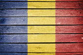 Romania, romanian flag painted on old wood plank background — Stock Photo