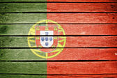 Portuguese, portugal flag painted on old wood plank background — Stock Photo