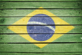 Brazil, brazilian flag painted on old wood plank background — Stock Photo