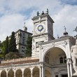 Clock Tower and statue in Piazza della Libertia, Udine, Italy - Stock Photo